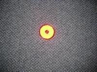 Reflector oranje rond 60 mm met plak laag